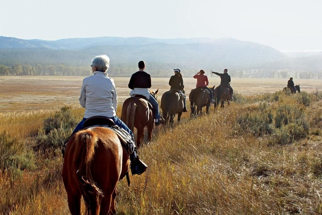 Paws Up_family members on horses