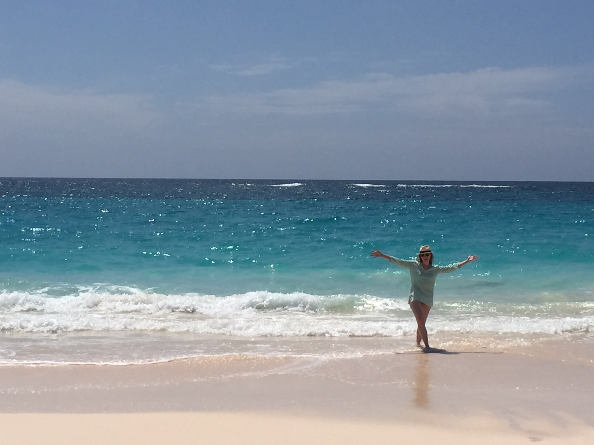 Enjoy your trip knowing your travel advisor has your back, like this Brownell Traveler at Elbow Beach in Bermuda.