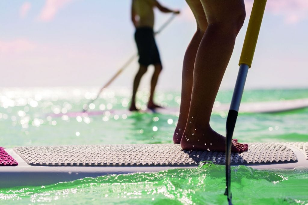 Take yoga to a new level by trying it on a paddleboard!