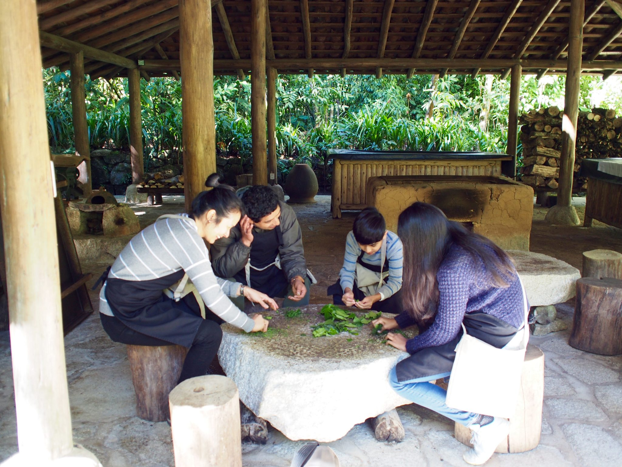 Karen and her children learning to process tea leaves at Inkaterra Machu Picchu Pueblo Hotel.